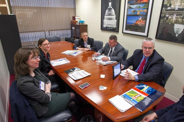 Maine delegation in 2014 with Peter Merfeld presenting the 2013 Report Card for America's Infrastructure app to Senator Susan Collins (Maine) staff member John Kane.