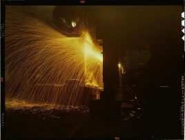 A welder who works in the round-house at the Chicago and Northwestern Railway Company's Proviso yard. Chicago, Illinois, December 1942. Reproduction from color slide. Photo by Jack Delano. Prints and Photographs Division, Library of Congress