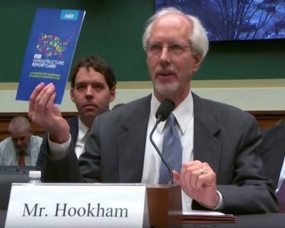 Mr. Hookham discussing infrastructure report card at a hearing
