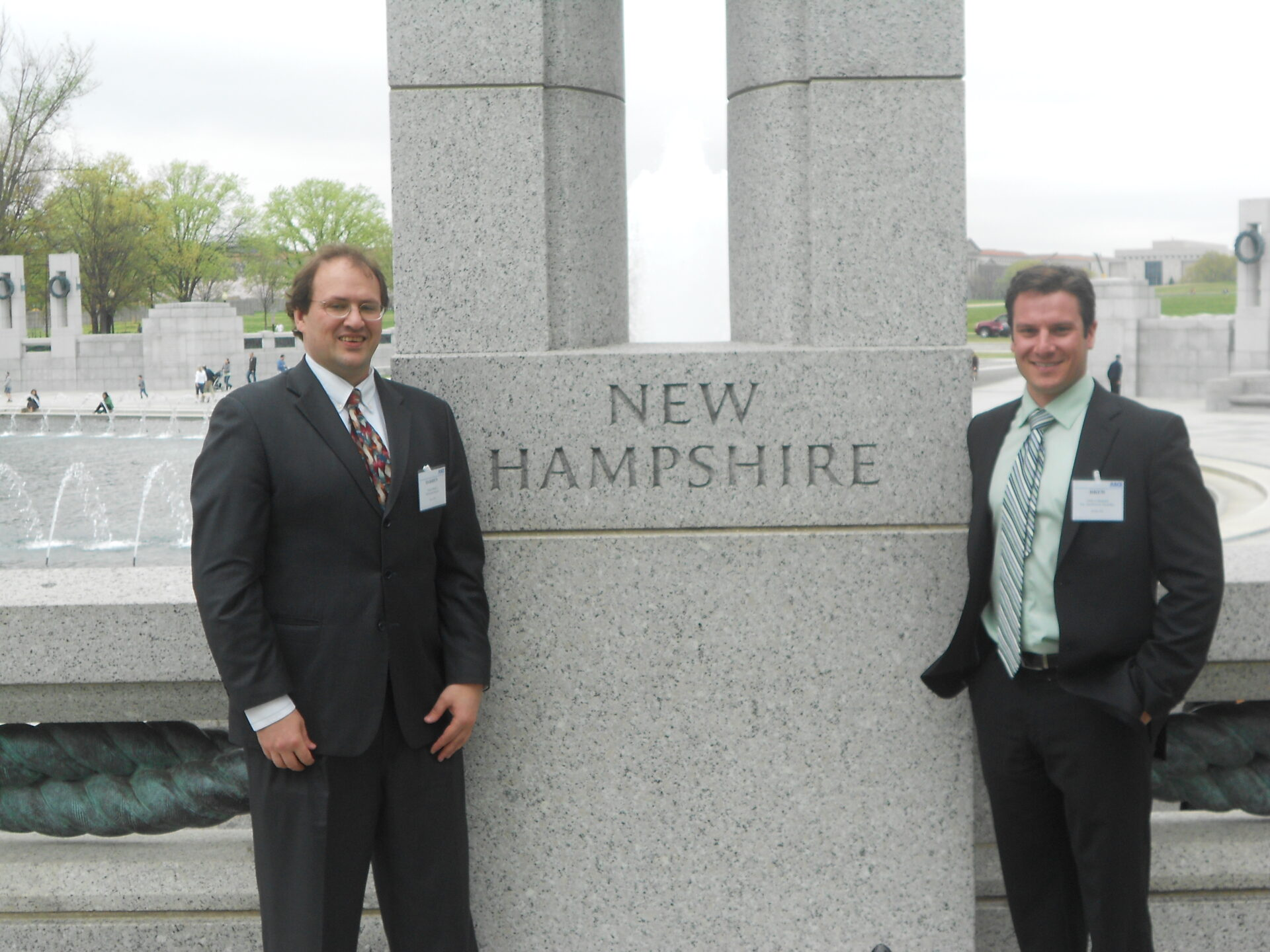 two men in front of New Hampshire stone in DC